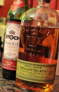 A bottle of Stock Sweet Vermouth with a bottle of the Rye Whisky