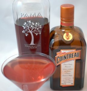 Pomegranate Martini with Pama and Cointreau bottles