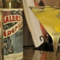 White Negroni served up in a martini glass